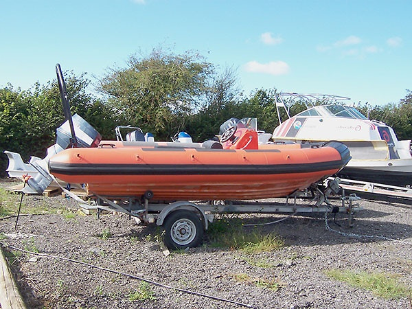 Avon Searider Retube in Orange with rubbing strakes, lifline holders, abrasion patches and black bow