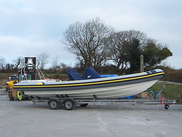 Scorpian 7. 5mtr RIB Retube in grey with yellow and black rubbing strakes,